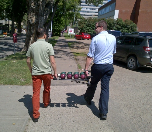 Carrying the bocce balls so the wheels don't fall off.